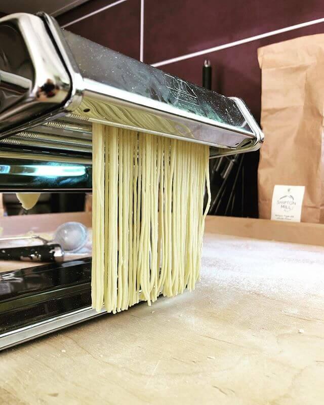 Marcato Atlas 150 pasta maker churning out freshly made pasta